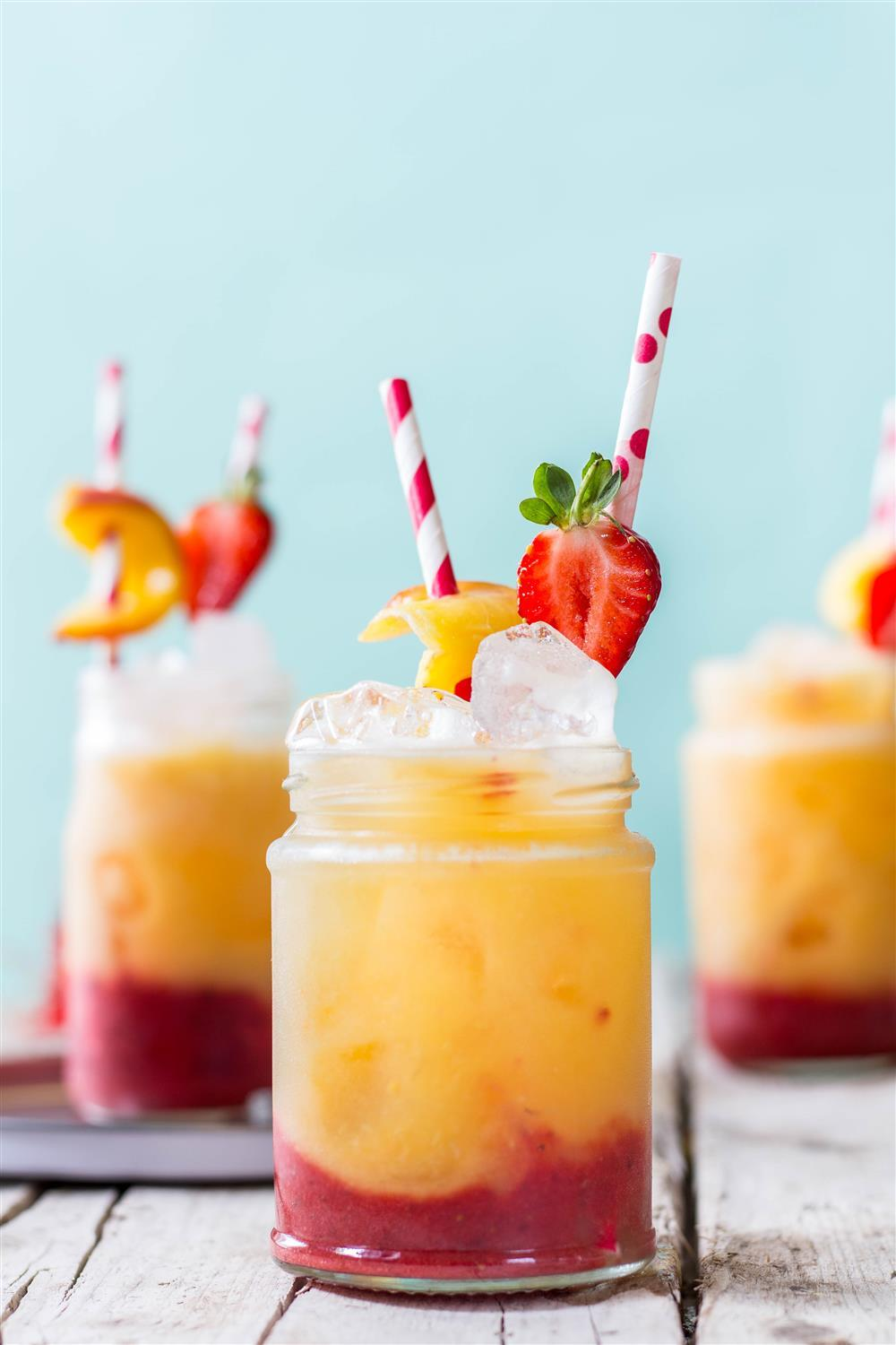 Delightful spring mocktail - roasted peach and strawberry fizz with no added sugar. Click to find the whole recipe or pin and save for later!