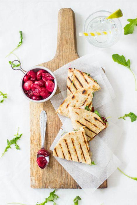A simple recipe for the perfect grilled quesadilla with cherries, gooey brie and bacon for a summer barbaque party.
