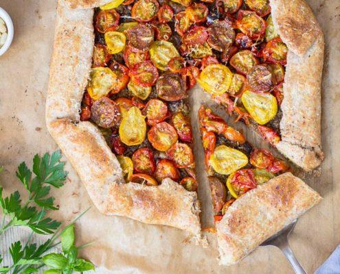 The sweetest most delicious tomato galette honoring the season of homegrown tomatoes.