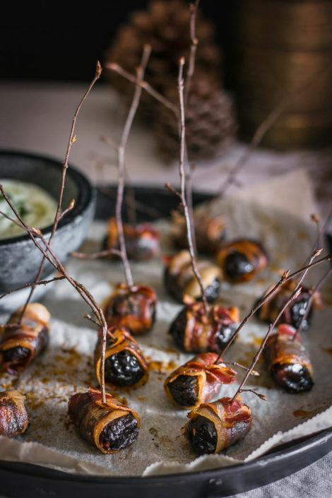 Indulgent finger food for the best party you'll ever throw, but not without these crispy bacon wrapped prunes and a decadent herbed feta dip!