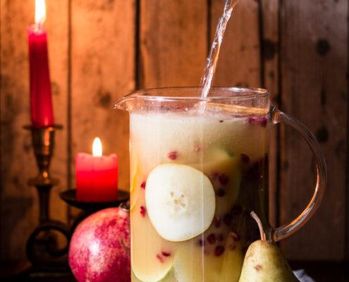 I love non-alcoholic festive sangria, especially when it tastes like winter with all its beautiful mixed fruits and christmas spices. It's the easiest thing in the world to do and you can prepare it ahead of time.