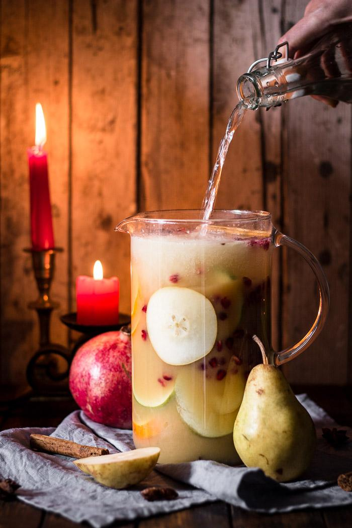 I love a non-alcoholic festive sangria, especially when it tastes like winter with all its beautiful mixed fruits and christmas spices. It's the easiest thing in the world to do and you can prepare it ahead of time.