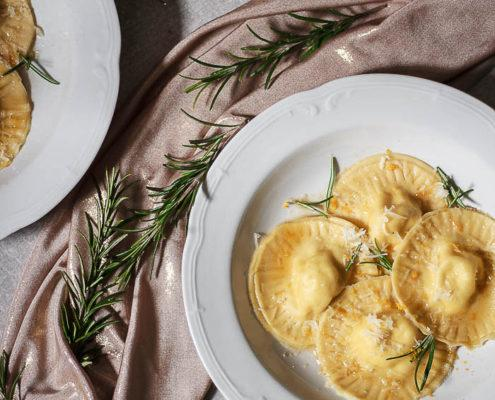 These humble but exciting pecorino ravioli with orange zest and brown butter flavored with rosemary will bring any dinner to a new level!