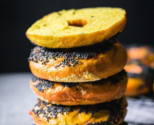 The softest low-fat black sesame covered chewy turmeric bagels that are ridiculously tasty and a great basis for a breakfast sandwich.