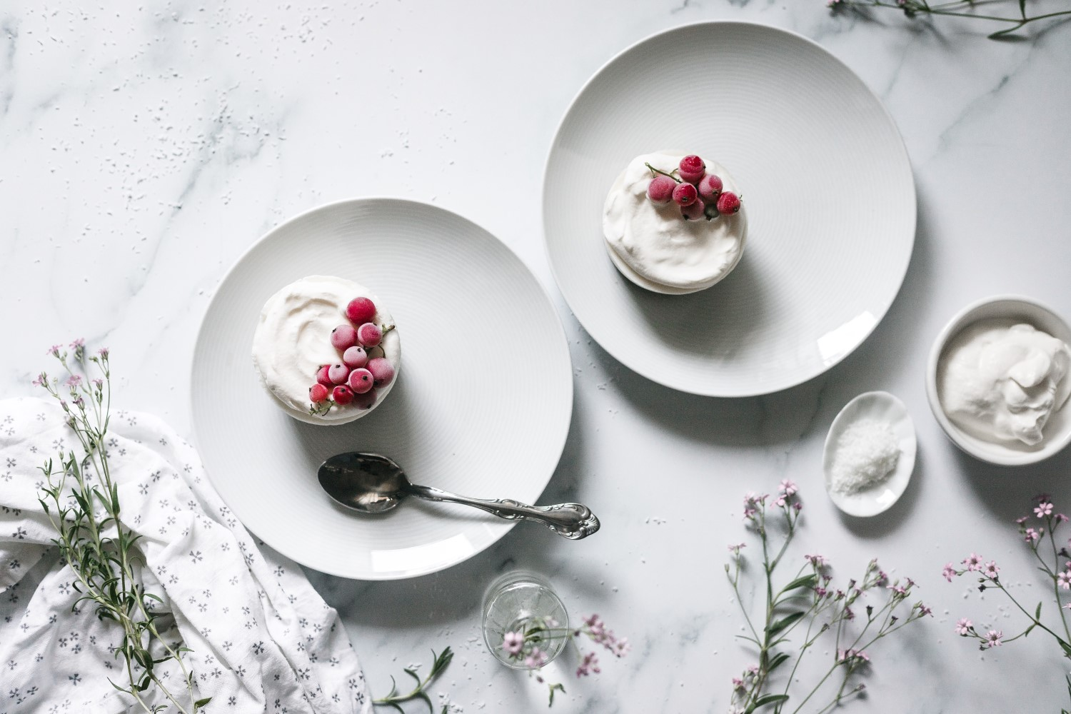 These no-bake frozen coconut cakes with sweet creamed coconut and Greek yogurt on top of a no-bake almond crust are the perfect summer desserts. Add some whipped cream and seasonal berries and you're in it for a win!