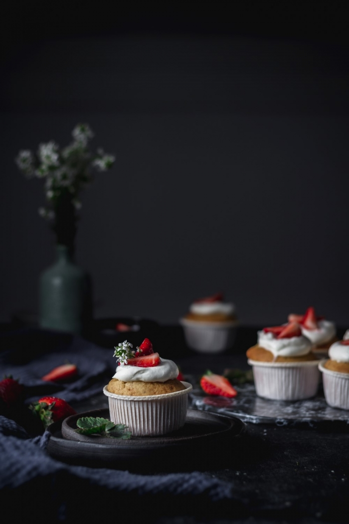 Strawberry yogurt cupcakes with whipped cream frosting and balsamic strawberries. One bite of these and you will agree, these are the best!