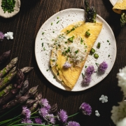 Perfect savory breakfast - soft and creamy asparagus omelet with parmesan cheese and some fresh chives. What could be better?