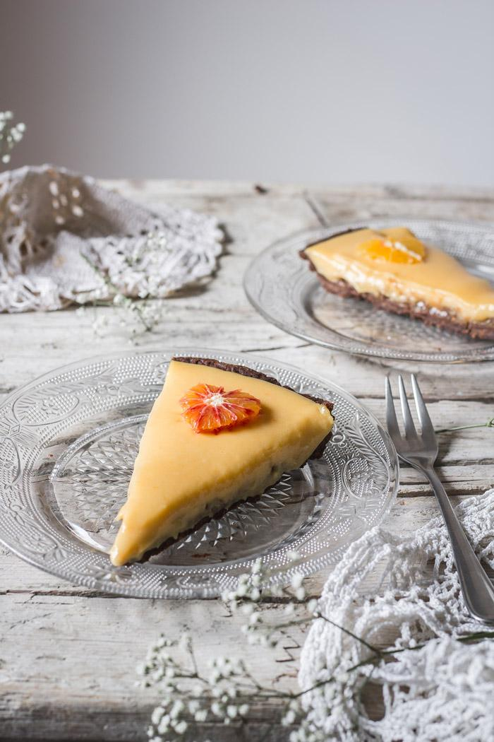 One of the best flavor pairings - dried figs and orange in a perfect Valentine's day dessert - a decadent dried fig and blood orange tart. Simple chocolate tart crust is holding a dried fig jam and a zesty blood orange curd, which is decorated with tiny orange hearts. What a treat!