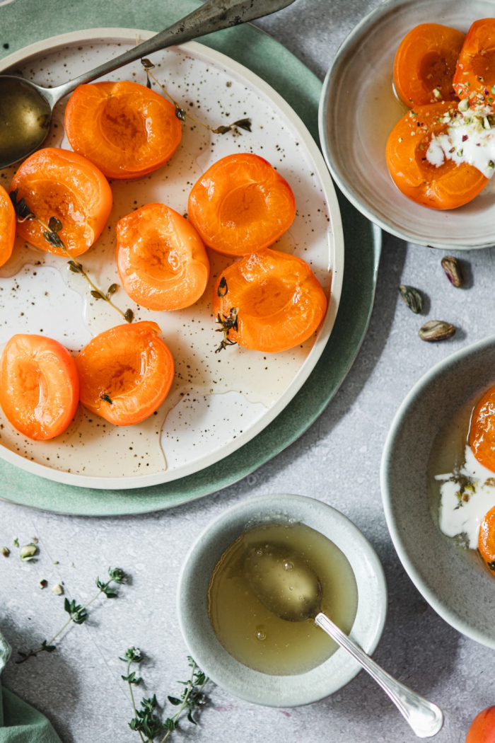 A light Summer dessert with ton of flavor - honey poached apricots. This soft and tender desserts melts in your mouth.