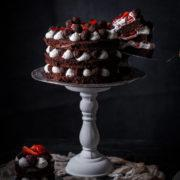 This strawberry chocolate cake with honey macerated strawberries and chocolate rhubarb truffles is perfect for any celebration and is super easy to make and so yummy.