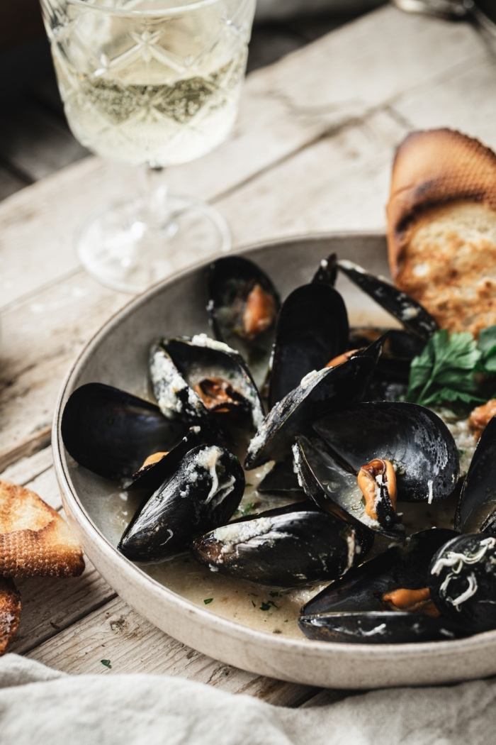 This Mediterranean style mussels recipe is the easiest and super delicious! With just a few simple ingredients you get maximum flavors. Wine, garlic, and parsley make the most delicious sauce.