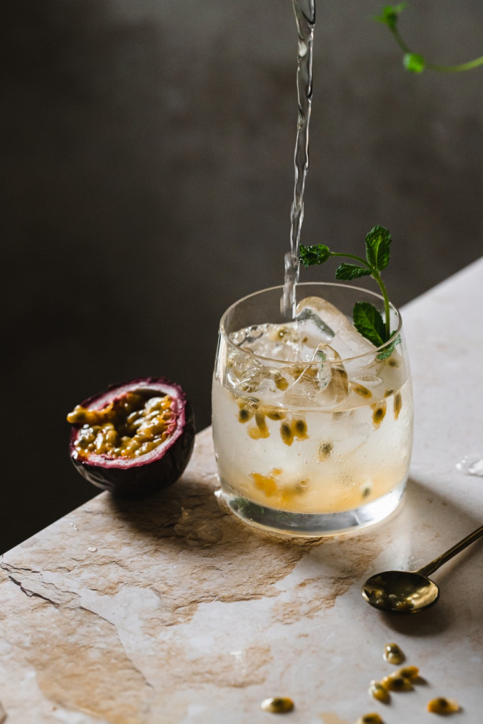 Fresh passion fruit and delicious floral elderflower syrup give this refreshing elderflower and passion fruit gin and tonic recipe a sweet valentine's day twist.