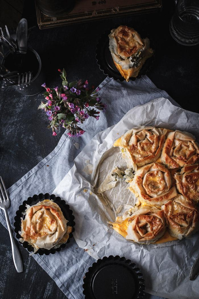 This chicken spanakopita (Greek spinach pie) is the best comfort food I can imagine for spring. Hearty and rich, flavored with cheeses, leeks and chicken, but also loaded with fresh spinach. And to top it all, it make s a perfect early picnic dish, since it is pull-apart. I don't think anything could make me more excited right now.