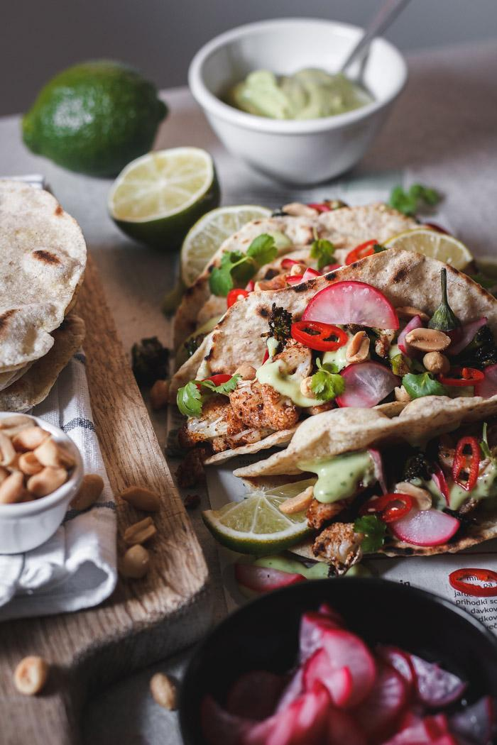 These quick and easy roasted broccoli and cauliflower mole tacos are such a nice healthy fresh lunch or dinner. With the addition of a 5-minute pickled radish and avocado yogurt sauce they make a perfect meal.