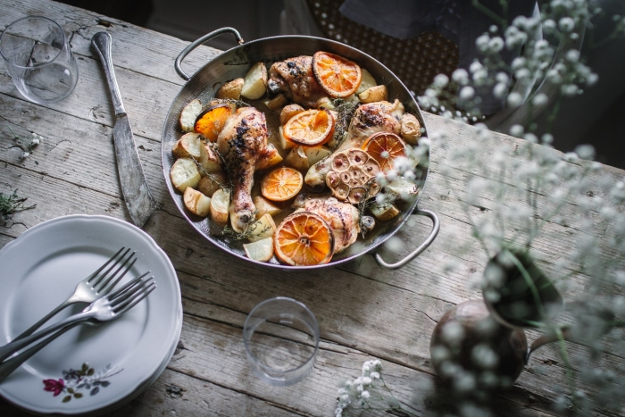 Tender roasted orange chicken marinated in orange juice and soy sauce served with roasted potatoes is a quick and easy dinner recipe everyone will love.