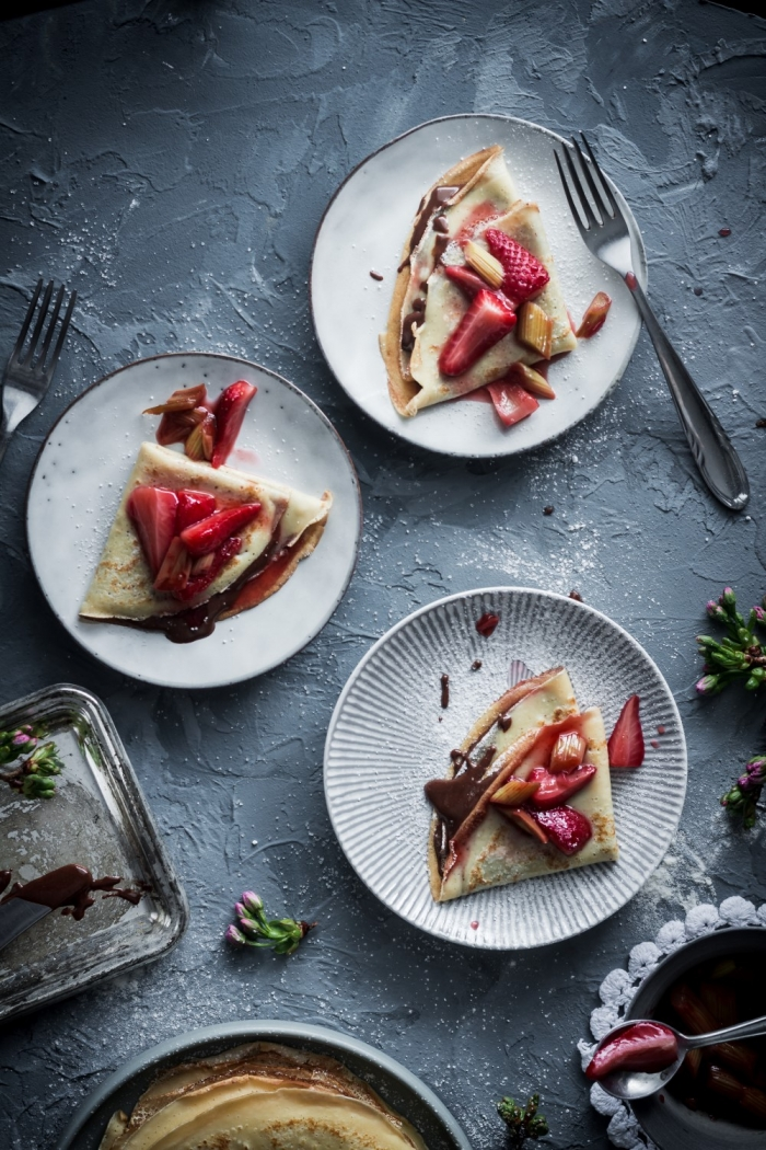 These roasted strawberry rhubarb crêpes with homemade chocolate and hazelnut spread are the perfect way to celebrate spring.