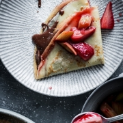 These vanilla crêpes with roasted strawberry rhubarb and homemade chocolate and hazelnut spread are the perfect way to celebrate spring.