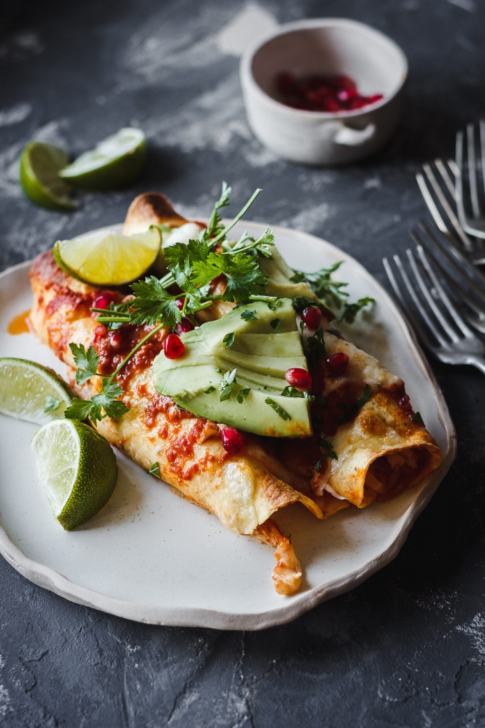 These shredded chicken enchiladas are my absolutely favorite enciladas. The recipe is super easy and it even includes a homemade enchilada sauce that's made with little effort in only 15 minutes.