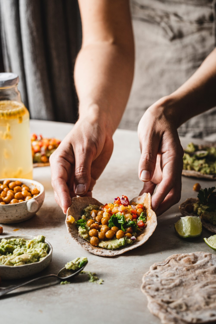 The best homemade chickpea tacos - filled with a creamy avocado spread, spicy roasted chickpeas and a vibrant fresh pineapple salsa.