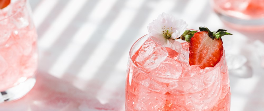 Learn this easy recipe for a fruity strawberry gin and tonic with homemade strawberry simple syrup. Only a few simple ingredients but so much flavor!