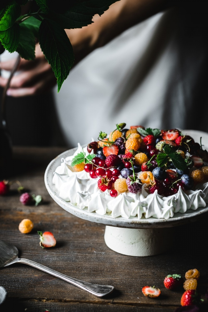 The best Summer berry pavlova is when fresh summer berries meet a crisp and chewy meringue and some fresh whipped cream.