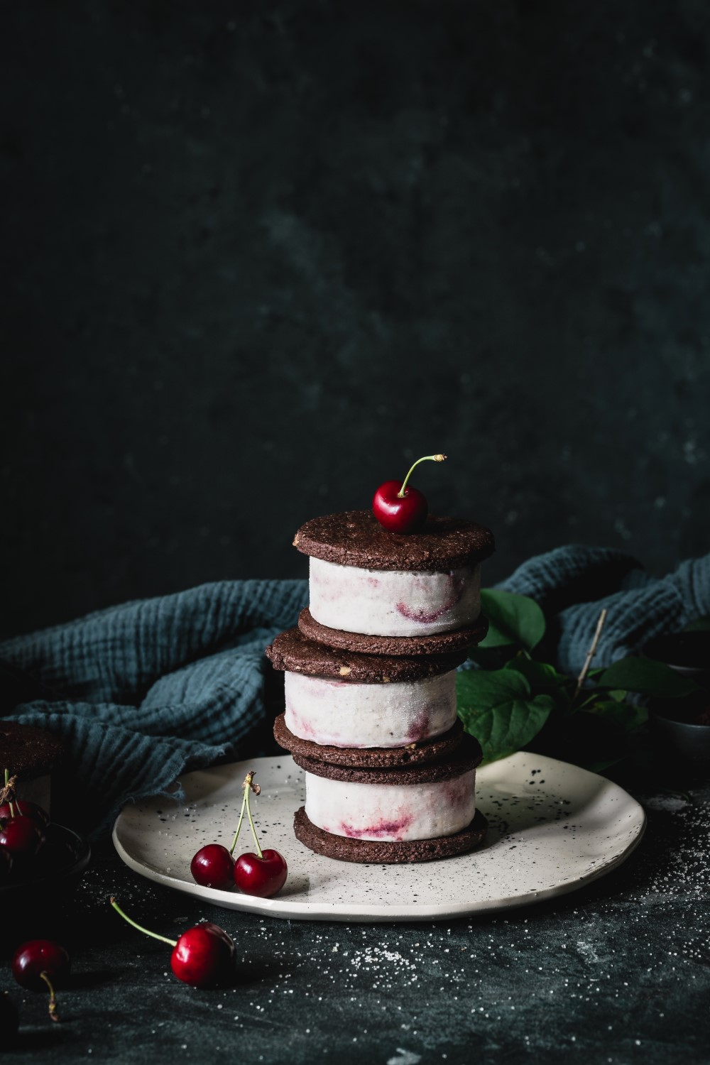 Wrap your hands around something wonderful with this vegan cherry almond ice cream between two delicious almond chocolate cookies.